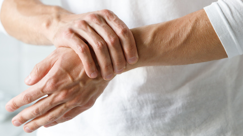 A person experiencing pain in their wrist