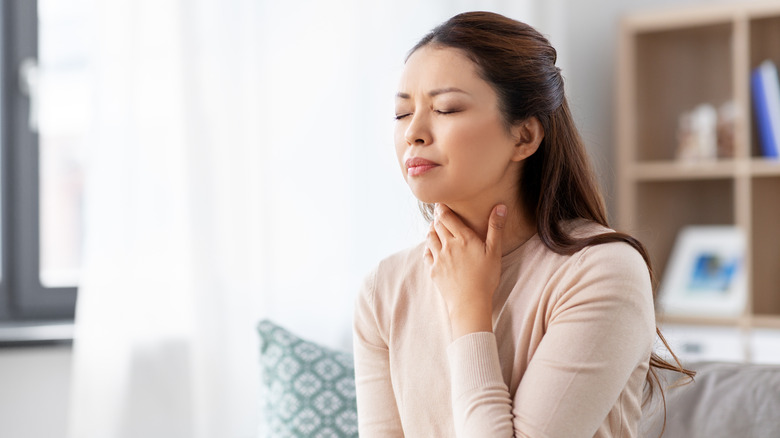 Woman with throat pain