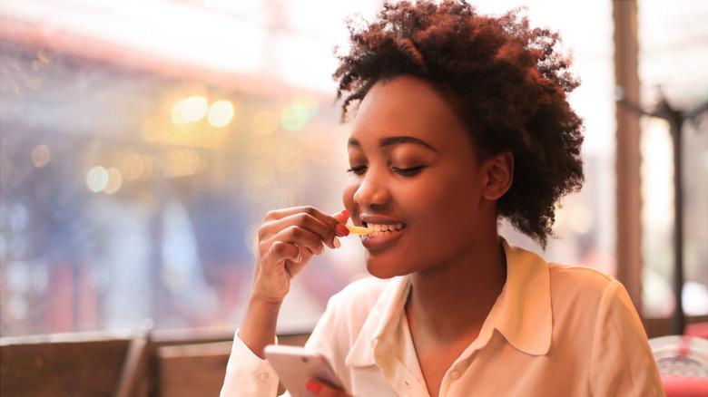 Woman enjoying a salty snack