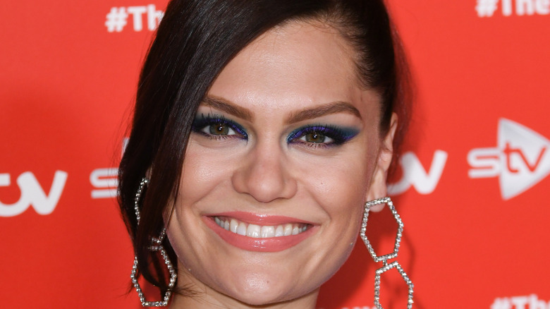Jessie J smiling on a red carpet