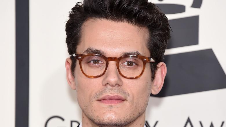John Mayer posing on red carpet