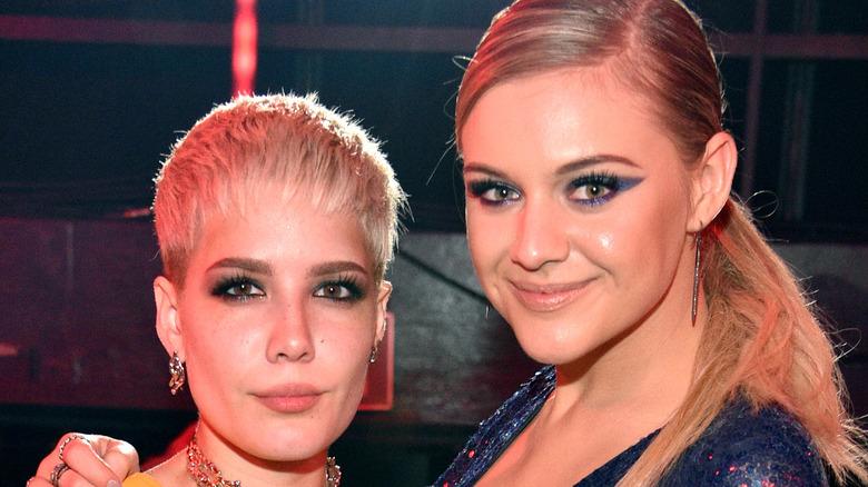Kelsea Ballerini and Halsey pose together backstage