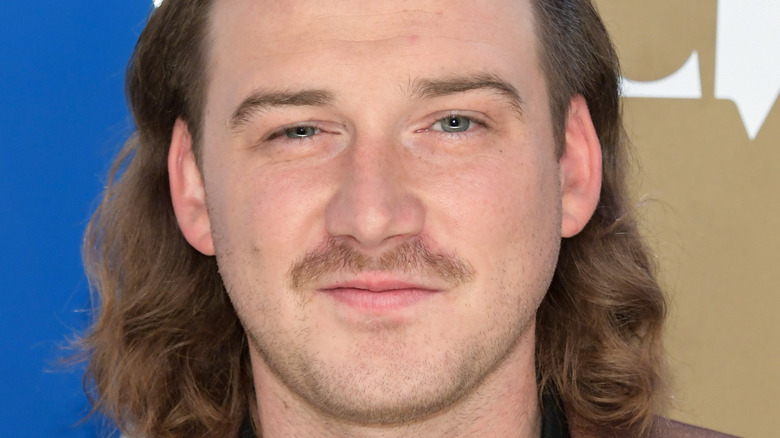 Morgan Wallen grinning with mustache