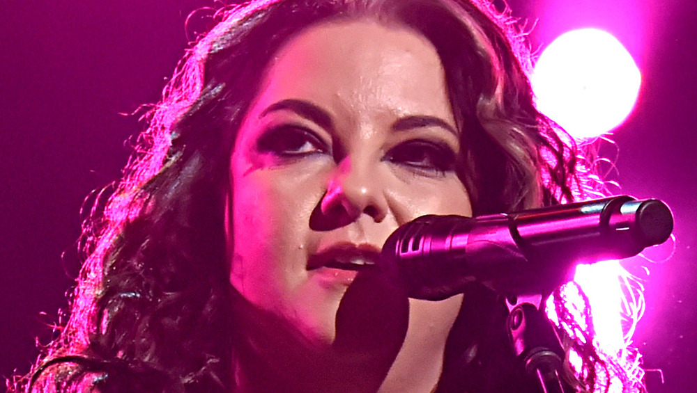 Ashley McBryde sings with curly hair
