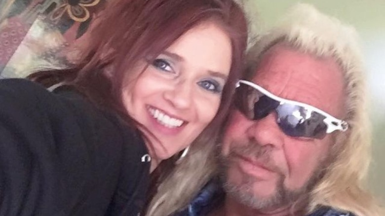 Dog the Bounty Hunter and Moon Angell pose for selfie