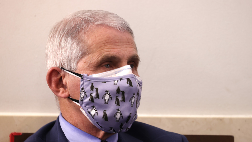 Dr Fauci with a penguin mask