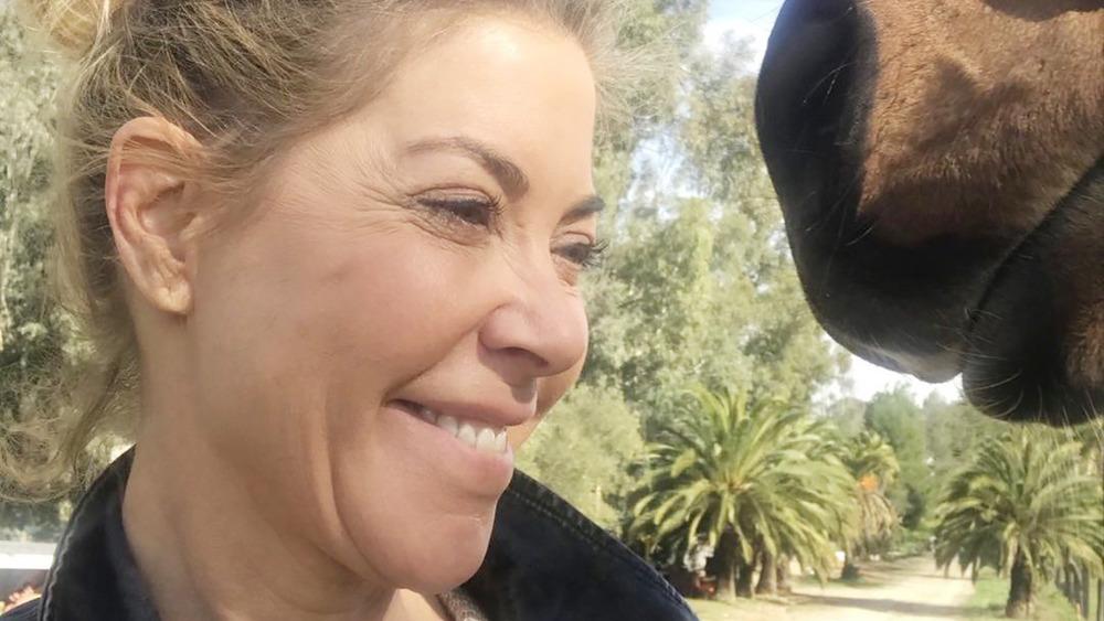 Elaine Culotti smiling at horse