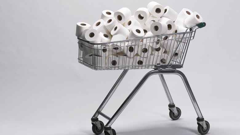 shopping cart filled with toilet paper
