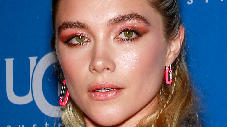 Florence Pugh poses in pink glitter eyeshadow