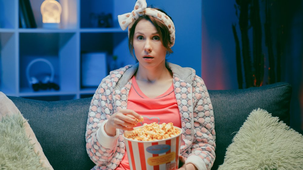 Woman binge-watching Netflix