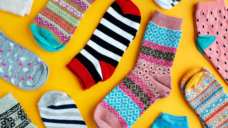 Colorful socks on yellow background