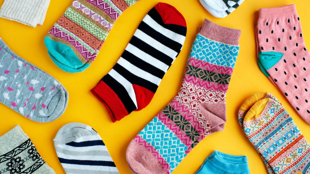 colorful patterned socks against a yellow background