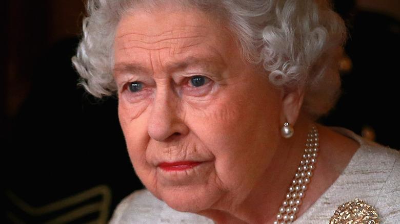 The queen looking somber
