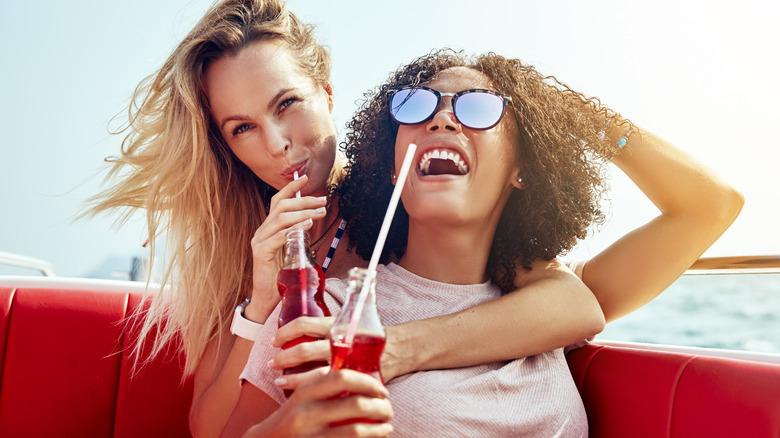 women drinking too much soda