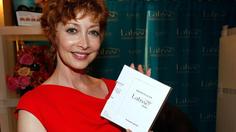 Actress Sharon Lawrence poses at the Latisse booth during the HBO Luxury Lounge in honor of the 61st Primetime Emmy Awards held at the Four Seasons Hotel