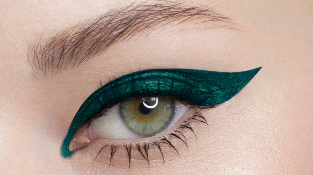 A woman wearing thick eyeliner