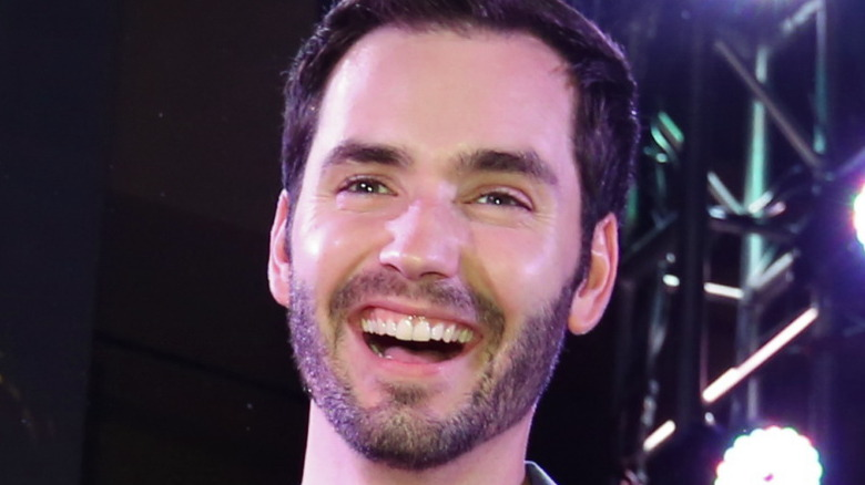 """Chris Siegfried of """"The Bachelorette"""" smiling at an event"""