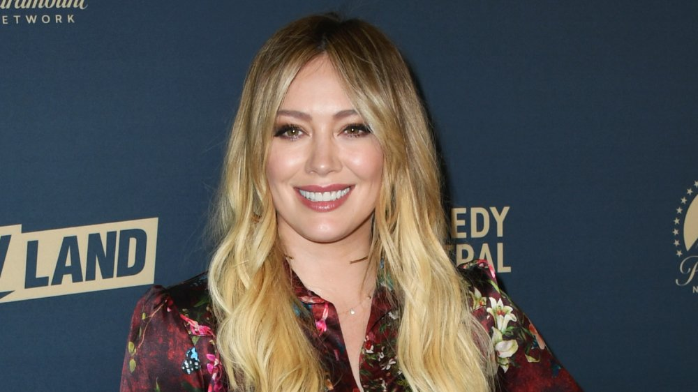 Hilary Duff on the red carpet, smiling