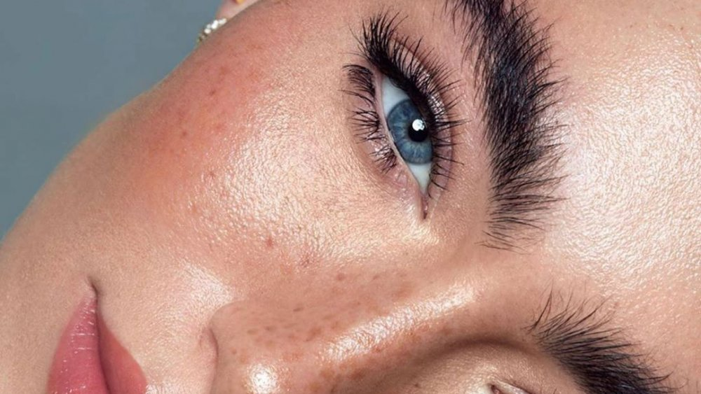 Model with dolphin skin makeup