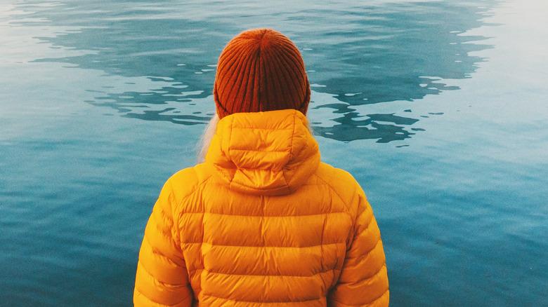Woman staring into a lake