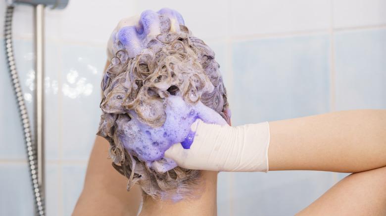 woman using purple shampoo
