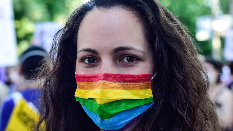 Woman wearing rainbow facemask