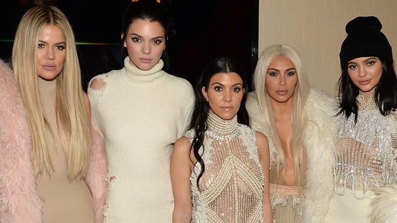 The Kardashian/Jenner sisters at an event.
