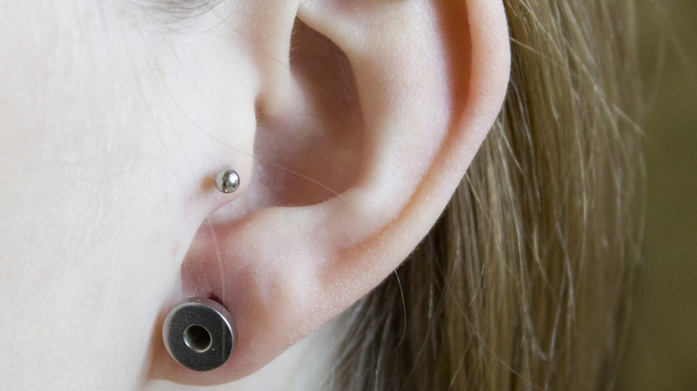 Woman with an ear gauge