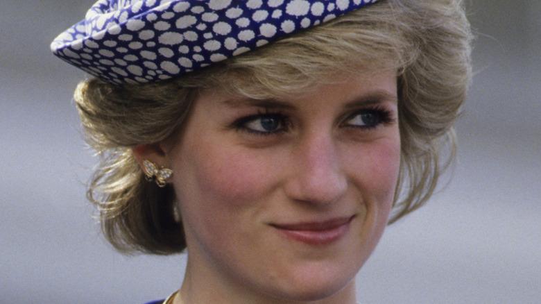 Princess Diana smiling in hat