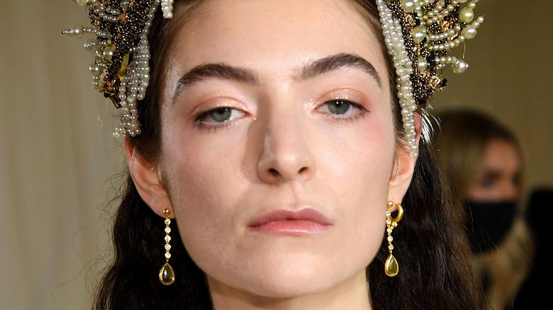 Lorde posing in crown