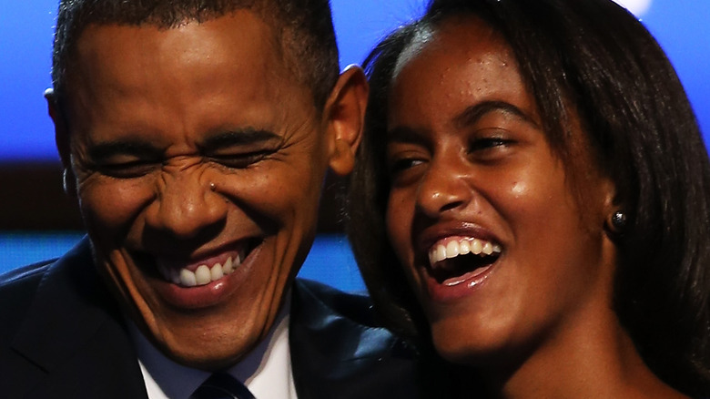 Barack Obama laughs onstage with daughter Malia