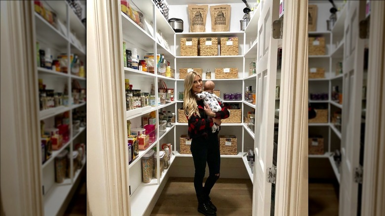 Christina Anstead in her pantry with baby Hudson