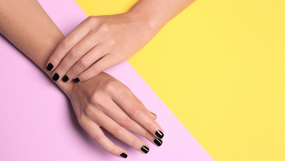 woman with black nail polish