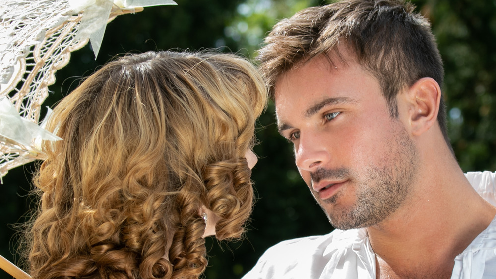 Victorian couple staring in each other's eyes