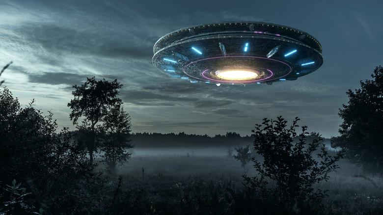 Alien spacecraft over field