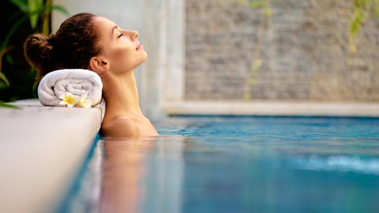 Woman sleeping in pool