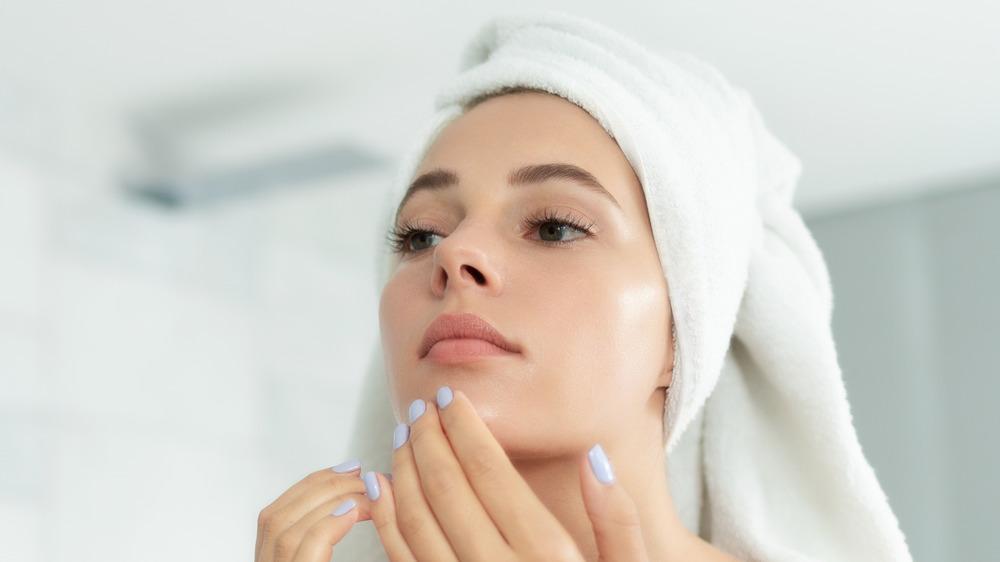 Woman scratching her chin