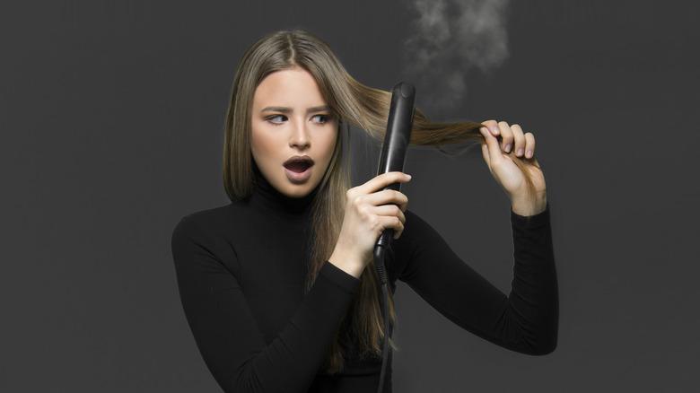 Woman looking at burnt hair