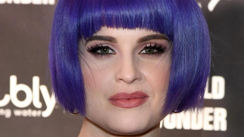 Kelly Osbourne posing, blue hair
