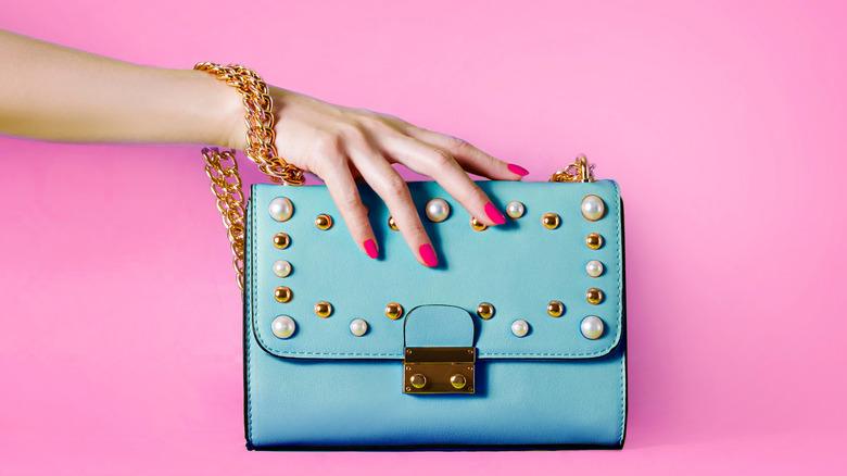 hand holding handbag