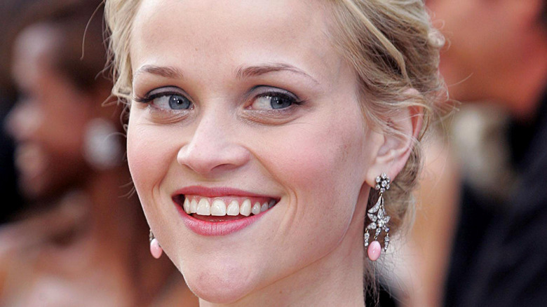 Reese Witherspoon poses on a red carpet