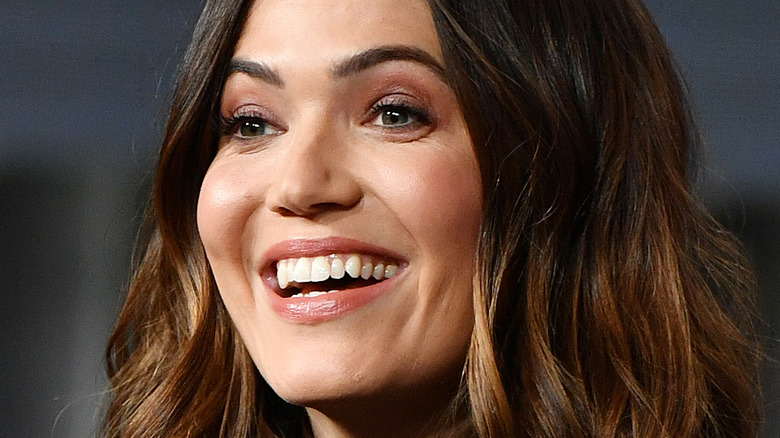 Mandy Moore smiling with hair down