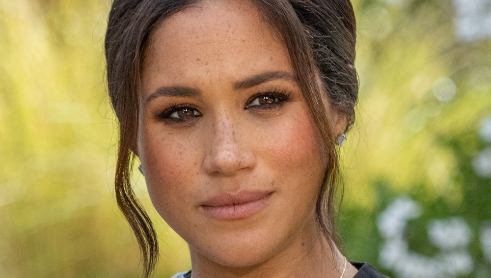 Meghan Markle looking serious during interview with Oprah