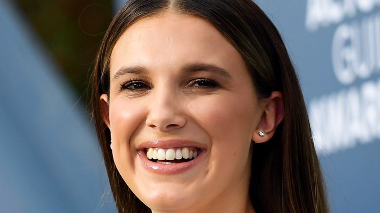 Millie Bobby Brown laughs on the red carpet