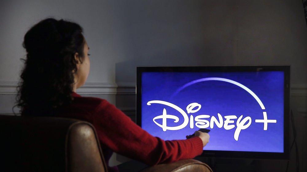 Woman watching a Disney movie