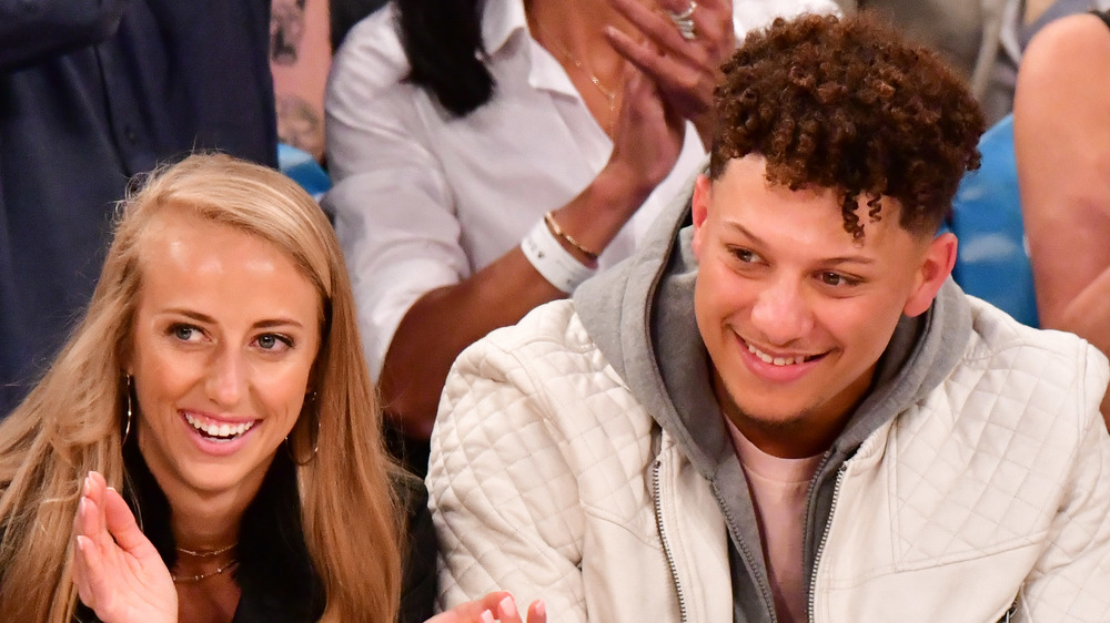 Patrick Mahomes and fiancée Brittany Matthews take in a basketball game