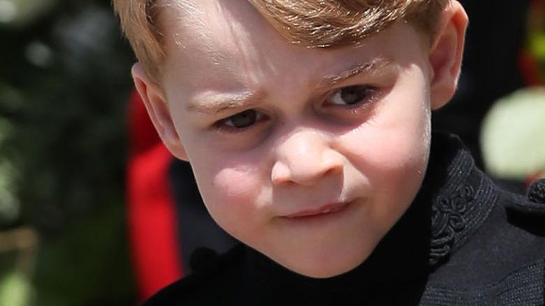Prince George walking outside