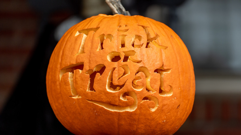 """Pumpkin with """"Trick or Treat"""" carved into it"""