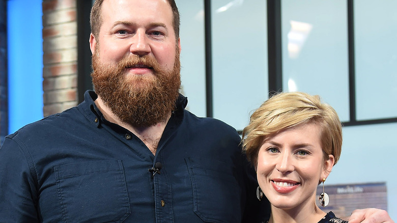 Erin and Ben Napier pose at an event