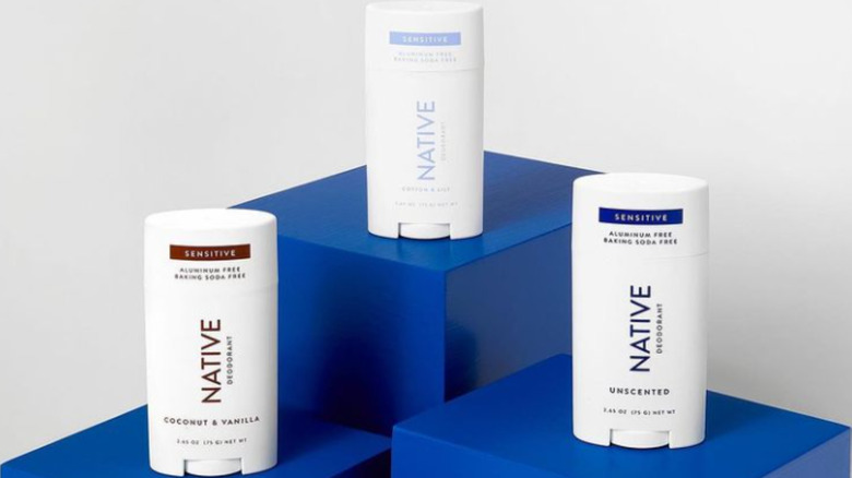 Native deodorants on blue pedestal